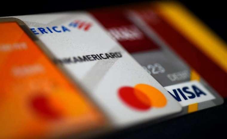 許多美國人無法使用信用卡 (圖: AFP)