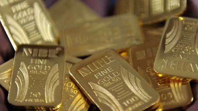 國際黃金價格驚驚漲,外銀預估金價Q3可望上看2000美元。(圖:AFP)
