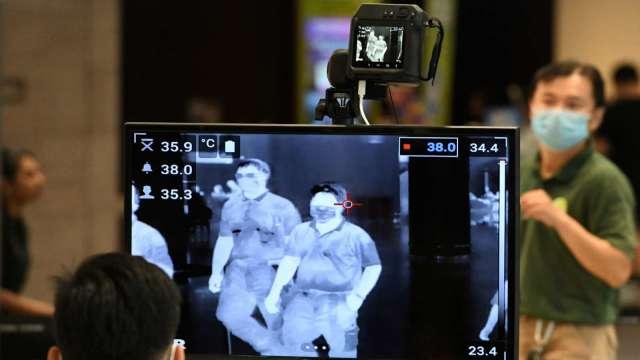 台新冠肺炎再添4例 1移工返泰確診不排除為本土病例。(圖:AFP)