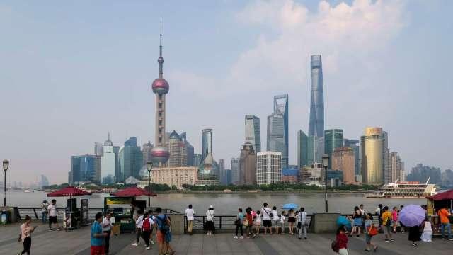 外需拖累新訂單指數 7月財新中國服務業PMI降至54.1(圖:AFP)