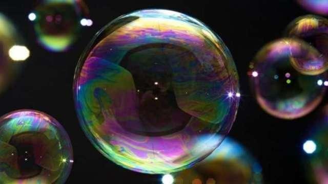 分析師表示科技股已形同泡沫,那斯達克恐遇10%修正。(圖:AFP)