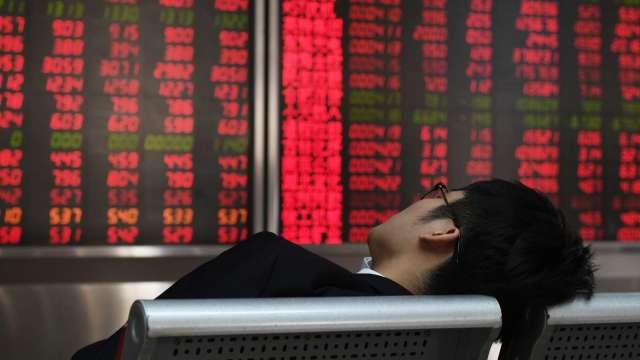 滬深兩市成交值不足兆元 上證指數微漲0.04%(圖:AFP)