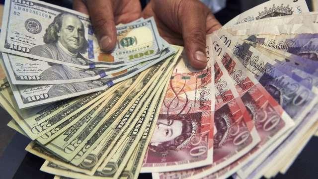 〈紐約匯市〉風險情緒高漲 美元創下10年來最長週跌勢 歐元走強(圖片:AFP)