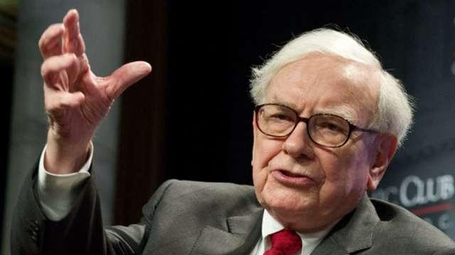 向來不看好黃金 巴菲特為何買金礦股、出清高盛? (圖:AFP)