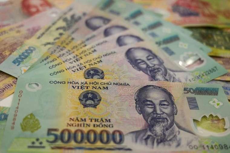 美國財政部週二表示,越南政府採取行動刻意壓越南盾兌美元匯率 (圖片:AFP)