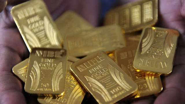 金價在鮑爾談話後上下劇烈波動 週五亞洲盤中繼續走高(圖:AFP)