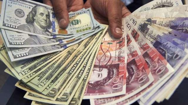 〈紐約匯市〉ECB憂歐元升值美元、歐元走軟 英鎊觸及6天低點(圖片:AFP)