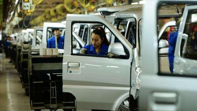 〈鉅亨看世界〉中國大賣的迷你電動車 (圖片:AFP)