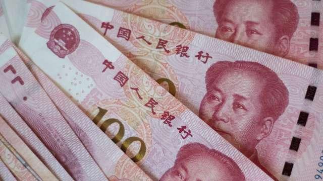 大摩:未來十年 人民幣可望躍升為全球第三大儲備貨幣 (圖:AFP)