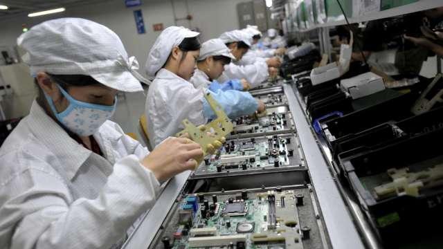 筆電、伺服器需求動能延續 雙鴻、奇鋐8月營收雙創同期高。(圖:AFP)