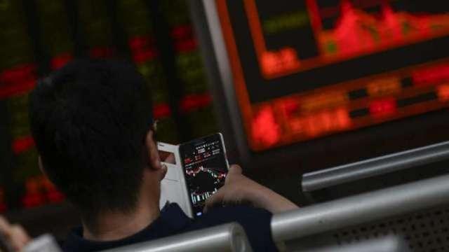 經濟內循環 中國股市走自己路。(圖:AFP)