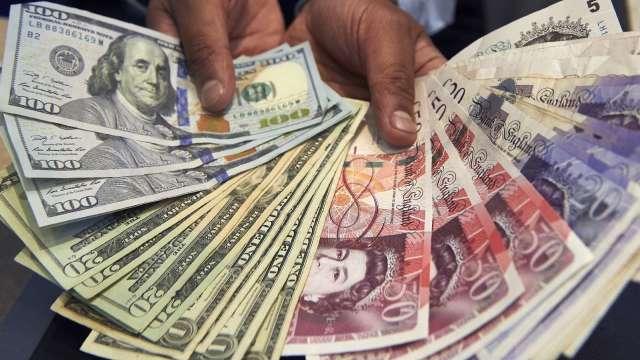〈紐約匯市〉美通膨優於預期 美元走軟 無協議脫歐風險增 英鎊萎靡(圖片:AFP)