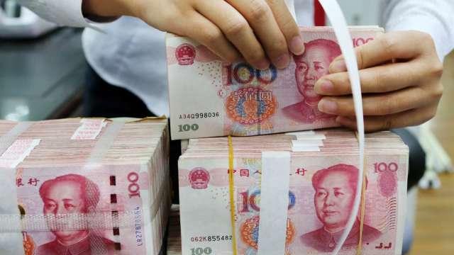 人民幣兌美元寫近16個月高點 激發做多情緒(圖:AFP)