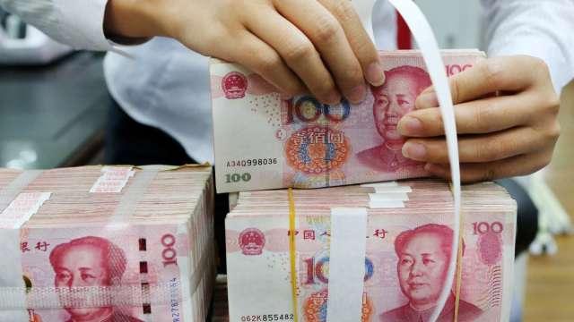 高盛:人民幣還將升值 未來12個月目標價上調至6.5(圖:AFP)