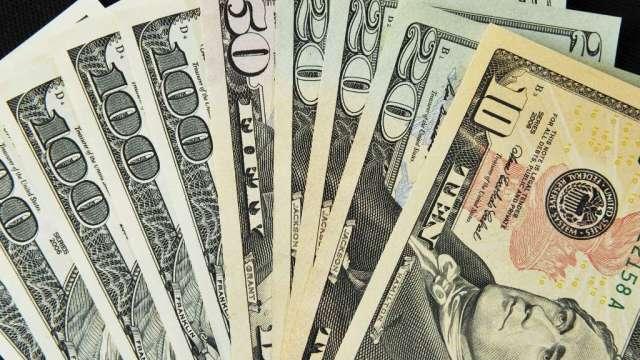 〈每週CFTC報告〉投機者繼續看衰美元 連3週增加黃金淨多單(圖:AFP)