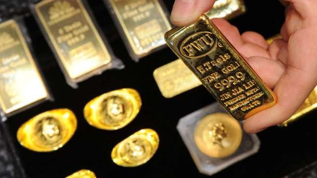 全球央行黃金購買創10年低點 預計明年回升(圖:AFP)