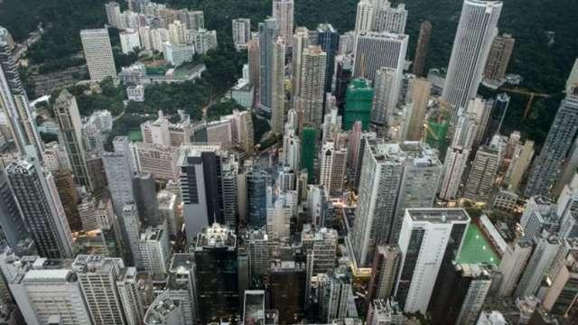 中國十一長假房市熱 房市調控再增兩城(圖片:AFP)