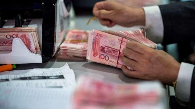 中國央行出手阻升 分析師仍看好人民幣走高、美元續貶(圖:AFP)