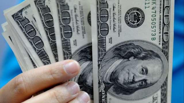 投機者連3週加碼美元多頭 整體格局轉為看漲(圖:AFP)