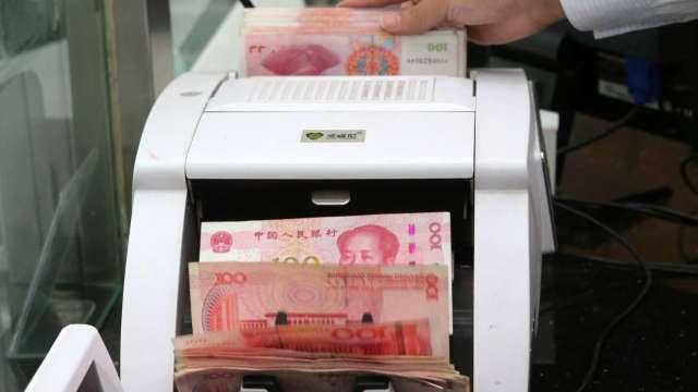 人民幣飆高之際 分析師認為拜登當選可能助漲人民幣(圖:AFP)