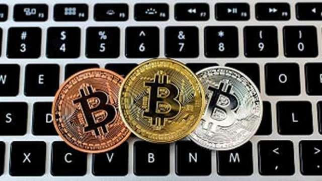 PayPal擬開放加密貨幣交易,比特幣攀上13000美元,板卡廠可望受惠。(圖:AFP)