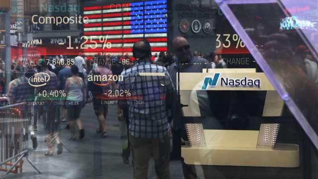 資金行情炒熱股市,讓美股也成為投資人競逐新標的。(圖:AFP)