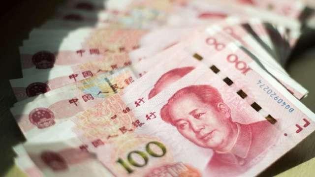 放寬資金外流阻升人民幣  傳中國QDII將擴容100億美元。(圖:AFP)