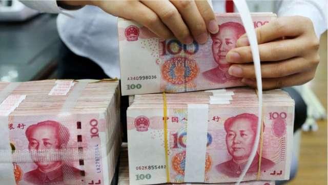 中國外管局:今年人民幣匯率彈性增強 企業應加強風險預防 (圖:AFP)