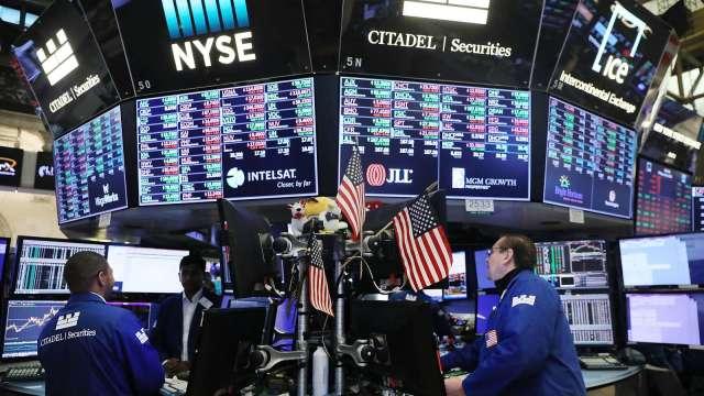 美國大選落下序幕 全球股債市勁漲。(圖:AFP)