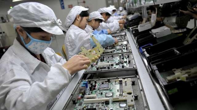傳違規蘋果擬終止合作 ,和碩:積極改善、現有業務不受影響。(圖:AFP)