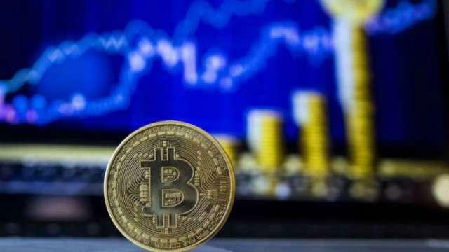 比特幣一路狂飆 衝破1.7萬美元大關。(圖片:AFP)