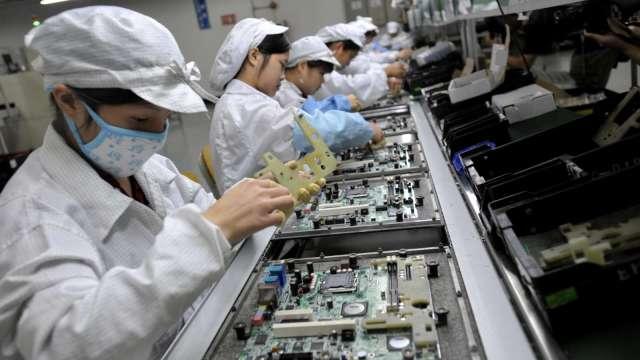 洋華Q4機電穩健、光電回溫,明年貼合服務效益顯現。(圖:AFP)