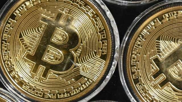 未來十年內或將有15兆美元資金流入黃金和比特幣(圖片:AFP)