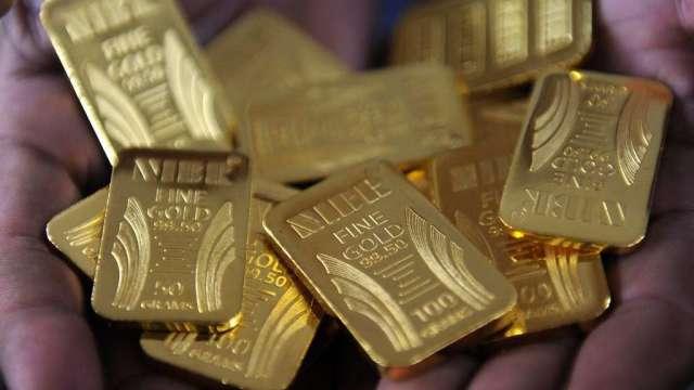 ANG Traders:金價有望回彈至1900美元 但未來半年走勢有變數(圖:AFP)