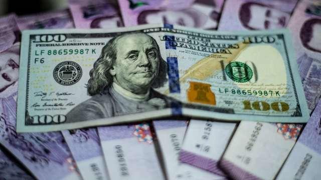 後市看空情緒轉濃 美元兌主要貨幣探多年新低 (圖:AFP)