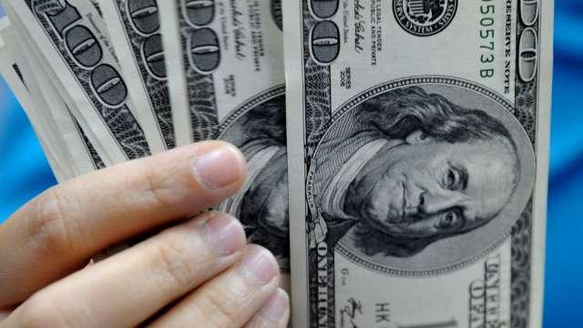 投機者增持美元指數空單 加碼看多黃金部位(圖:AFP)