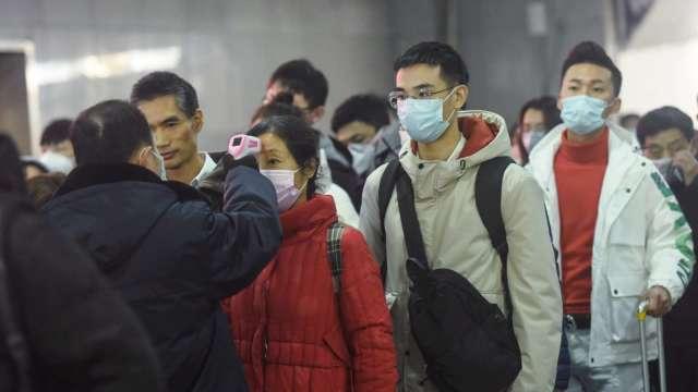國內外十大新聞事件,萊劑美豬、新冠肺炎疫情居冠。(圖:AFP)