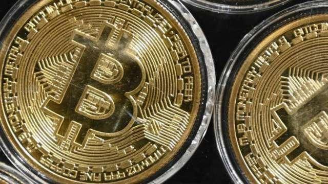 趁比特幣大漲試水溫 虛擬貨幣交易所Coinbase申請上市 (圖:AFP)