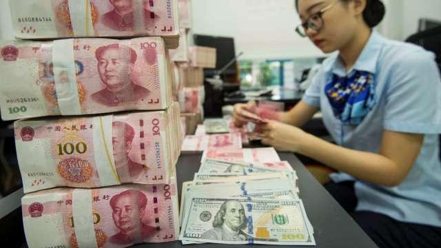 美元弱、資金強 新興債補漲行情到?(圖:AFP)