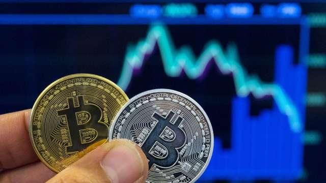 買黃金還是比特幣來避險?高盛:兩者共存沒問題(圖:AFP)