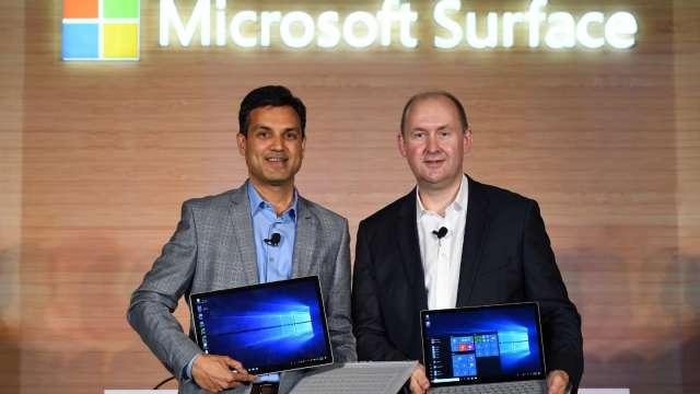 英特爾分手潮!微軟也打算為Surface筆電造自家晶片。(圖片:AFP)