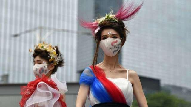 疫情讓人們必須戴口罩 意外幫助南韓醫美產業(圖:AFP)