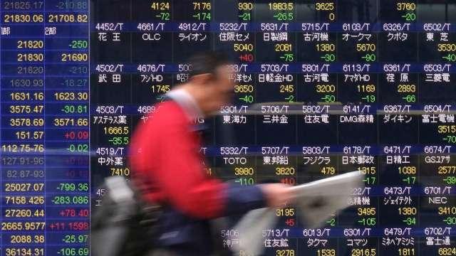 日本三大券商社長 針對2021年投資市場提出看法 (圖片:AFP)