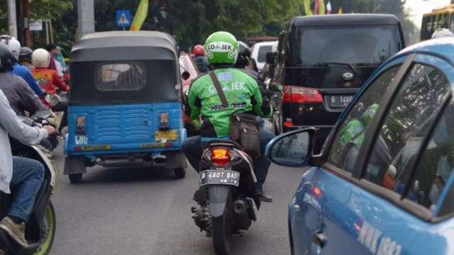 強強聯手!共享機車Gojek與印尼電商一哥傳合併好事近了 (圖:AFP)