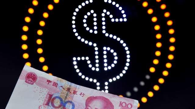 阻升人民幣再一招 中國人行上調境外放款係數(圖片:AFP)