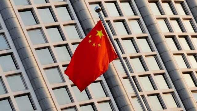 12月財新中國服務業PMI降至56.3 不如預期(圖片:AFP)