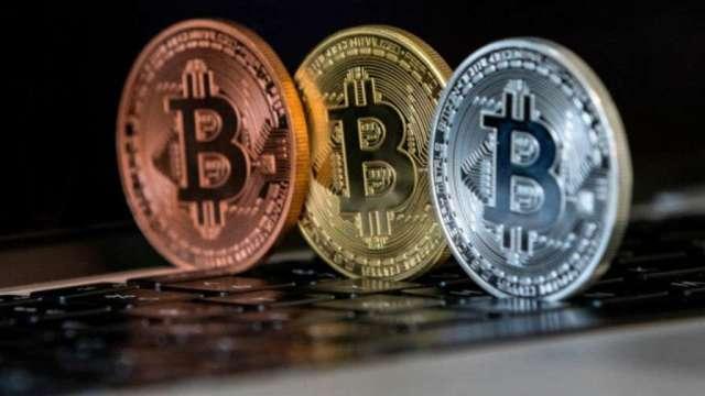 幣圈歡漲!比特幣首度飆破4萬美元 (圖片:AFP)