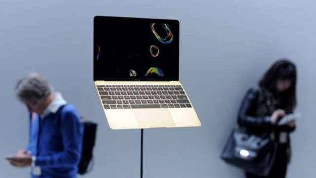 大摩:遠距辦公+筆電換機潮動能持續至今年 蘋果將受惠(圖:AFP)