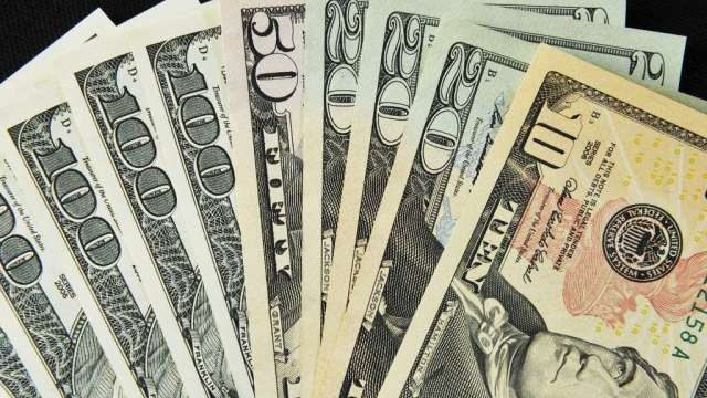 隨美債殖利率走高 投機客忙於回補美元空頭(圖:AFP)