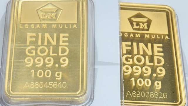 〈貴金屬盤後〉市場關注1800美元關鍵價 黃金逆轉收低(圖片:AFP)